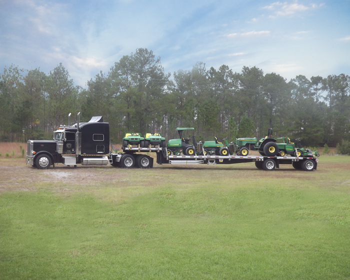 Titan Trucking Hauls John Deere Golf Course Equipment